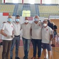 I volontari della Caritas in aiuto per il grande afflusso dei giovani alle vaccinazioni