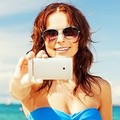 Selfie in vacanza: come tutelare la privacy sotto l'ombrellone