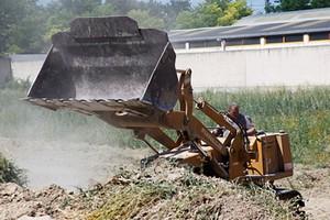 Via dei muratori escavatrice